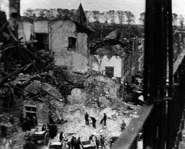 5th Camerons help to clear up after the town hall was blown up by German forces killing over 130 civilians